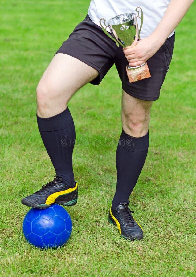 De trofee van de voetbalsterholding royalty-vrije stock afbeelding
