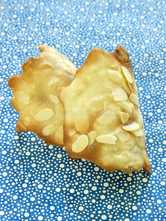 De tuile koekjes van de amandel stock afbeeldingen