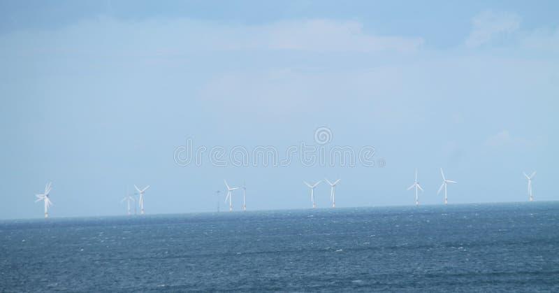De turbines van de wind, geel gebied stock afbeelding