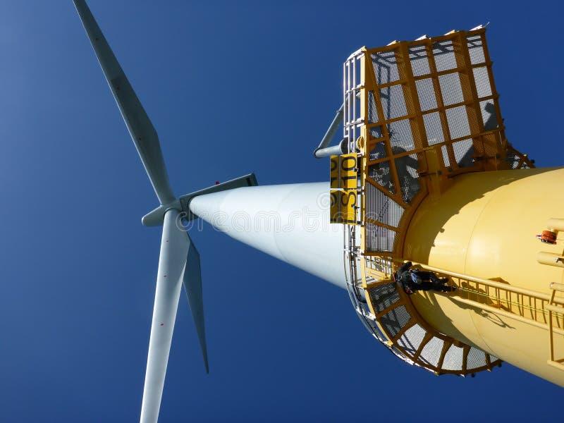 De turbines van de wind, geel gebied stock foto's