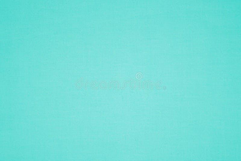 De turkoois gekleurde textuur van de canvasstof stock afbeelding