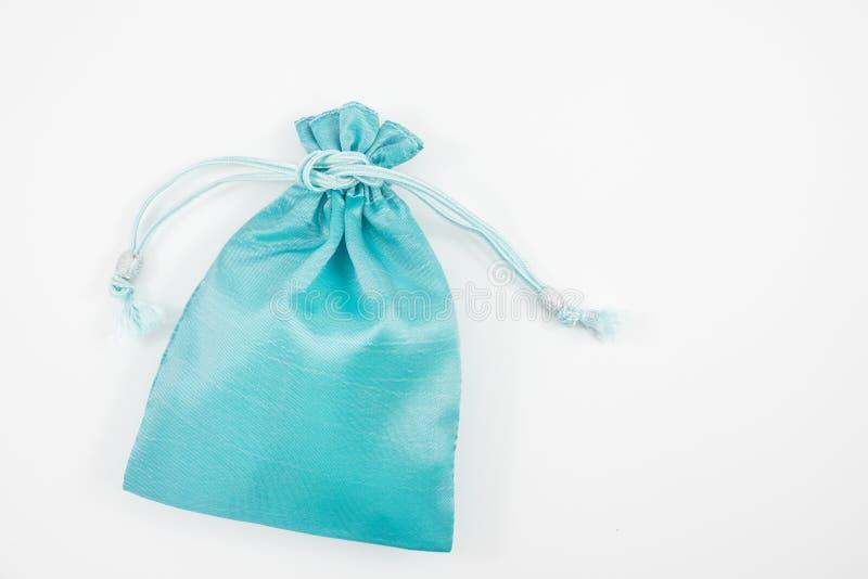 De turkooise blauwe de zakzak van de zijde minigift royalty-vrije stock afbeeldingen