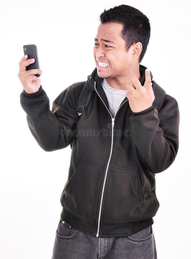 De uitdrukking van een mens die niet van de telefoon houdt stock afbeeldingen