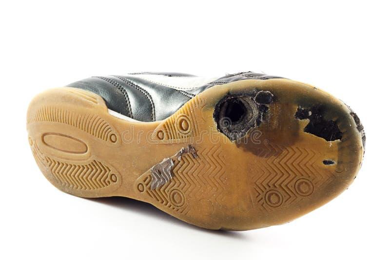De uitgeputte Schoen van Sporten met gat royalty-vrije stock afbeeldingen