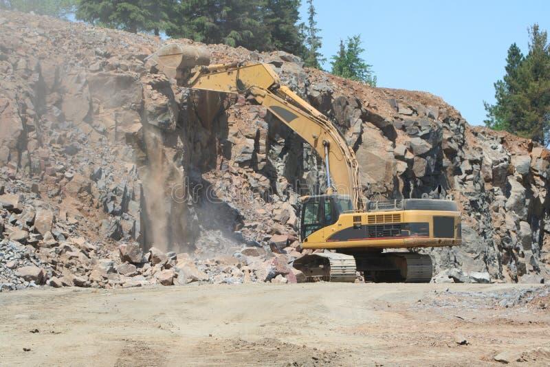 De Uitgraving van de rots stock afbeeldingen