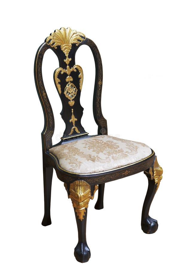 De uitstekende elegante donkere houten stoel met een zetel maakte in zijde op een witte achtergrond in orde royalty-vrije stock afbeeldingen