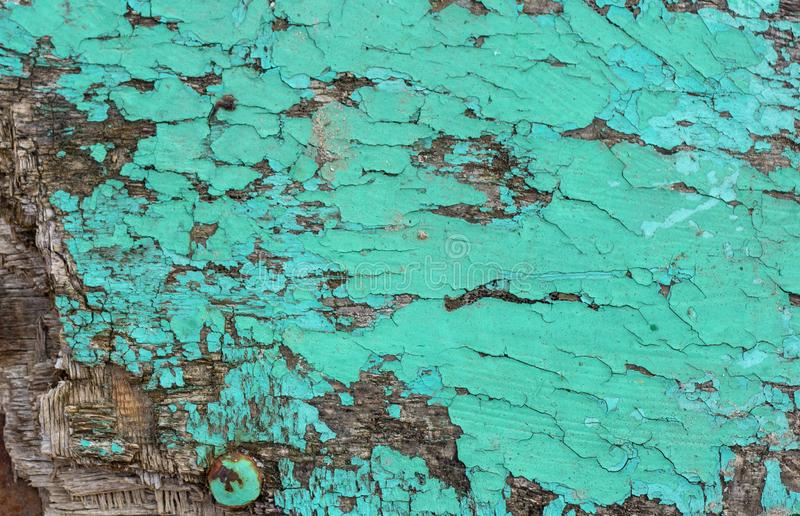 De uitstekende grunge rustieke houten geweven achtergrond met groene kleur barstte doorstane verf en krassen royalty-vrije stock afbeelding