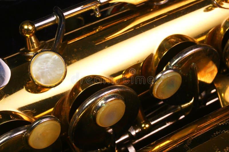 De uitstekende knopen van de Saxofoon royalty-vrije stock afbeeldingen