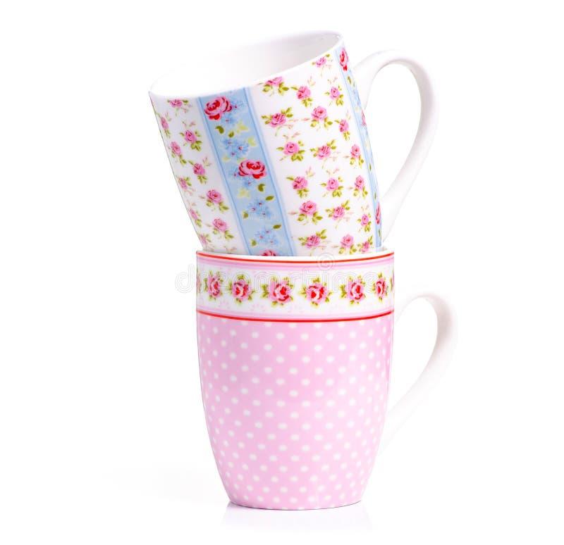 De uitstekende roze blauwe bloem van de koppenmok stock afbeelding