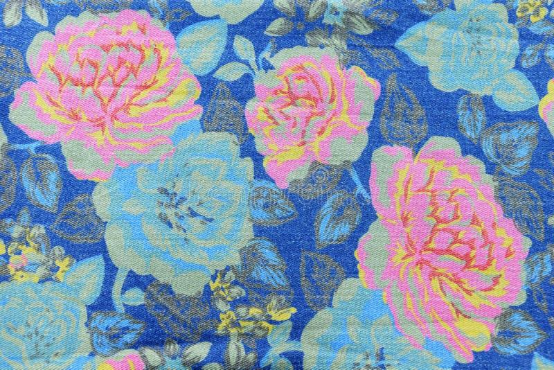 de uitstekende stijl van tapijtwerk bloeit het patroon van stoffenjeans backgroun stock afbeeldingen