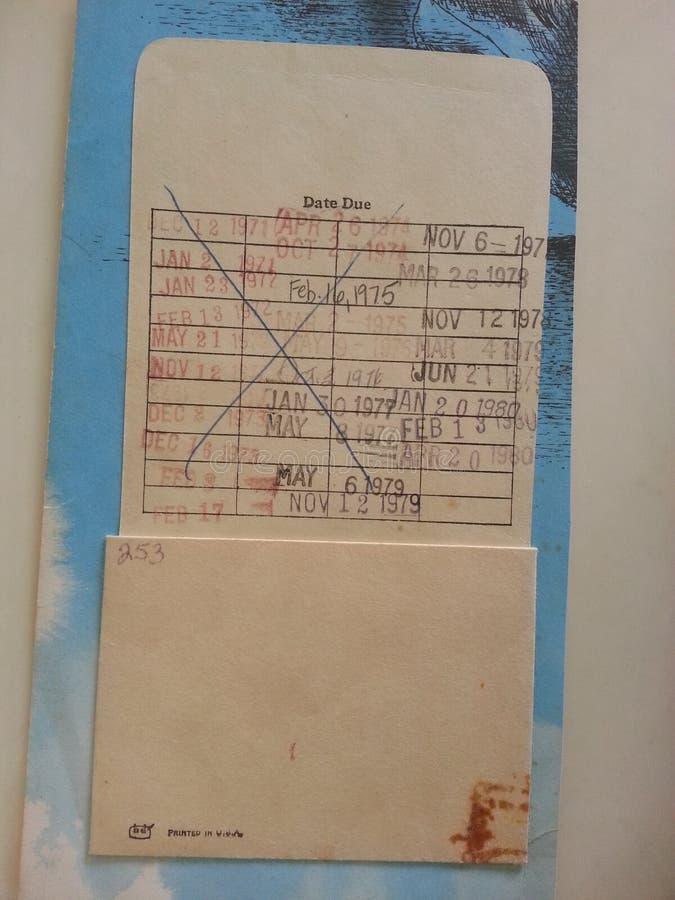 De uitstekende zak van het bibliotheekboek met Datum Gepaste zegels royalty-vrije stock fotografie