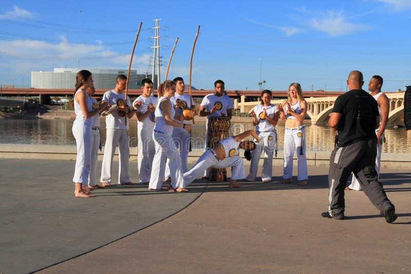 De V.S., Arizona:  Capoeira-Groep het Presteren royalty-vrije stock afbeeldingen