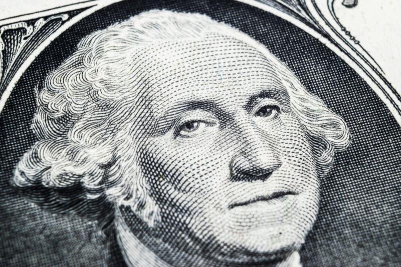 De V.S. het portret van het voorzittersgeorge washington gezicht op de V.S. één dollarnota Lage diepte van gebied Achtergrond van royalty-vrije stock foto's