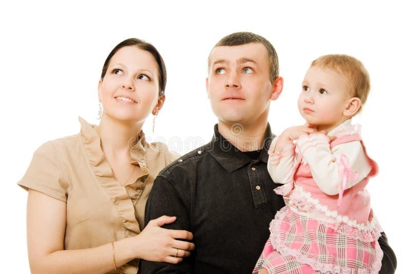 De vader en de dochter van de moeder kijken omhoog stock foto