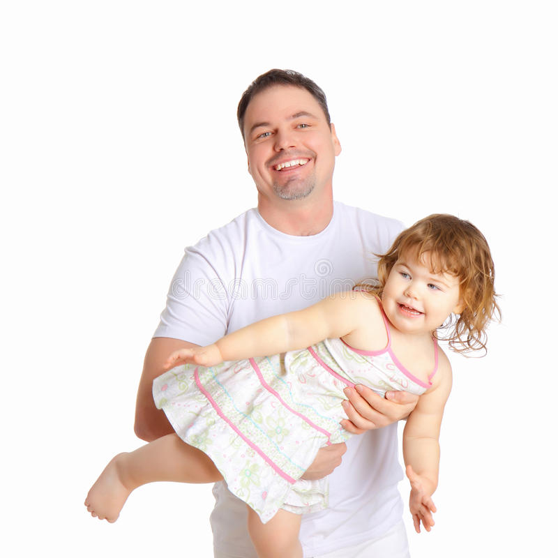 De vader houdt de kleine dochter in zijn wapens royalty-vrije stock foto