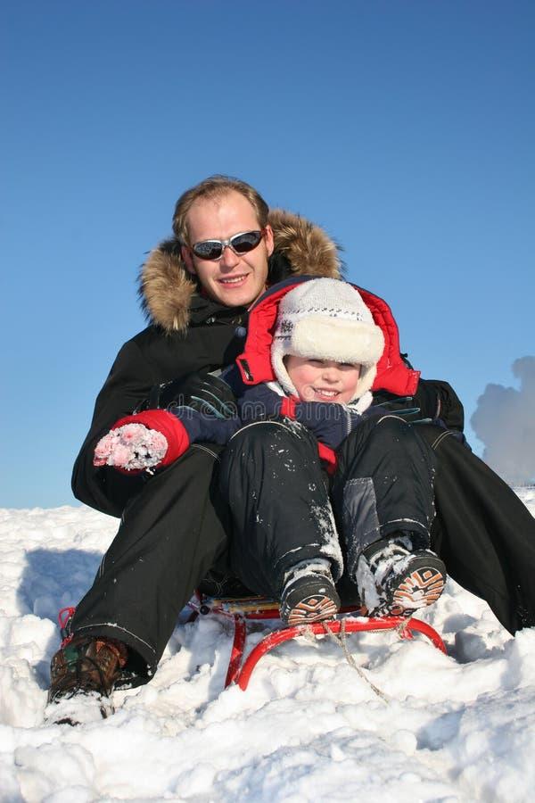 De vader van de winter met kind stock afbeelding