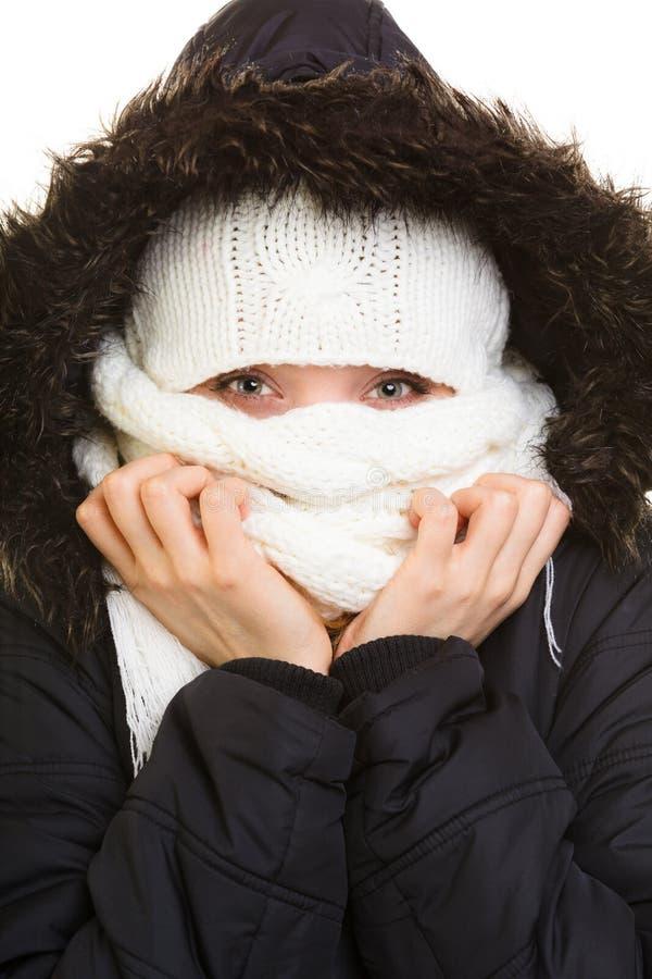 De vakantie van de winter Meisje die gezicht behandelen met sjaal royalty-vrije stock foto's