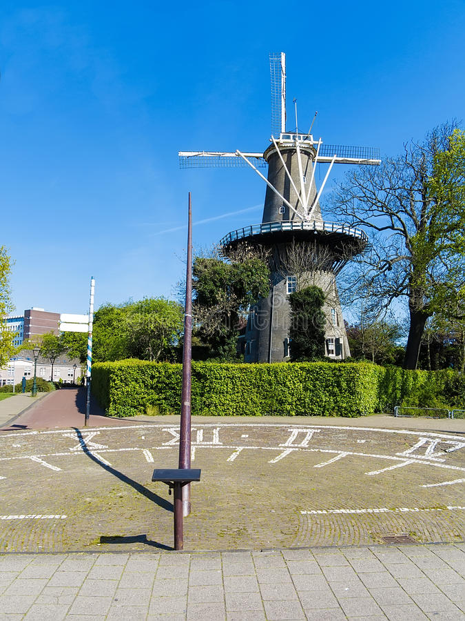De Valk, The Falcon Windmill. The solar clock and De Valk (The Falcon) is a tower mill, dating from 1743. It has 7 floors, all of which are open to the public royalty free stock image