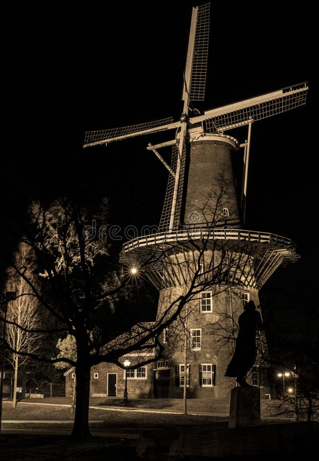 Mill ` De Valk` Leiden by night. De Valk is a tower mill and museum at the Lammermarkt in Leiden stock image