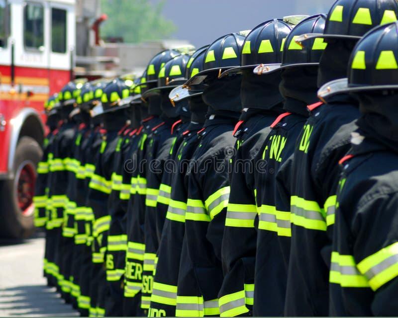 De Vechters van de brand in een Lijn stock afbeelding