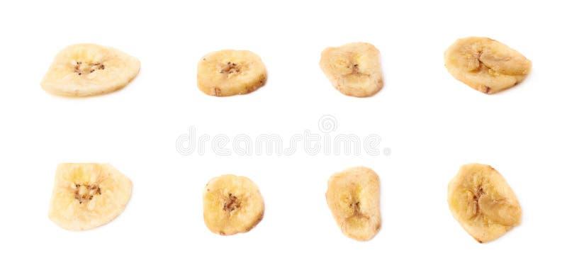 De veelvoudige droge banaan snijdt geïsoleerde snacks stock afbeeldingen