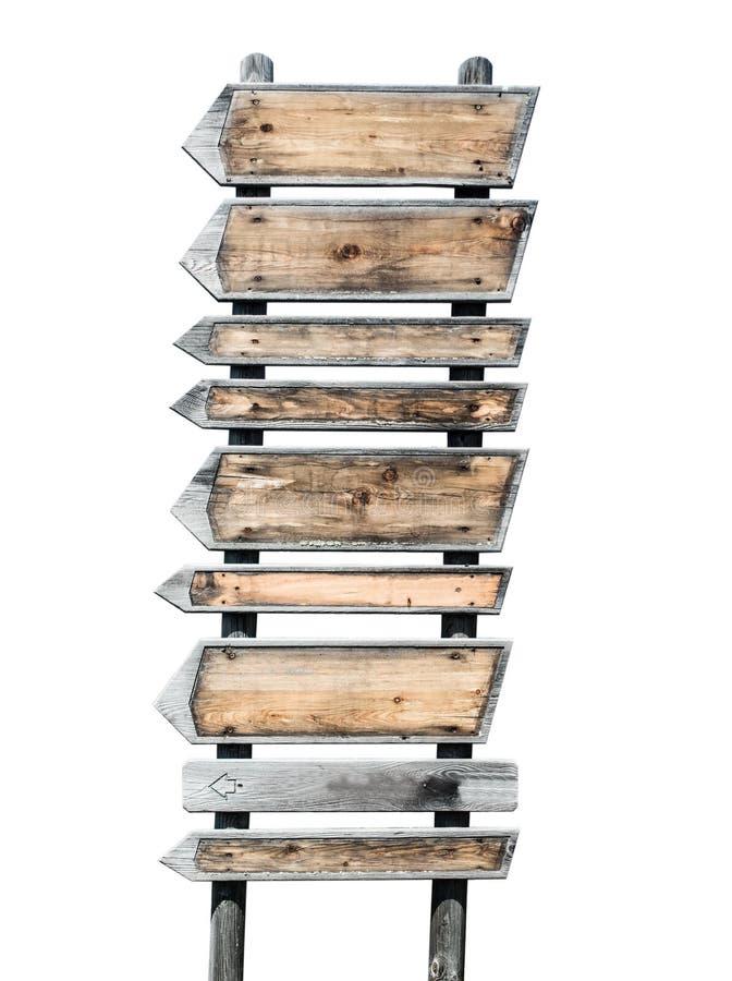 De veelvoudige rustieke houten pijlen op voorzien van wegwijzers stock afbeeldingen