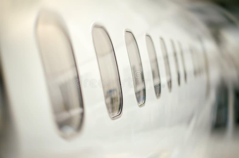 De vensters van passagiersvliegtuigen royalty-vrije stock foto's