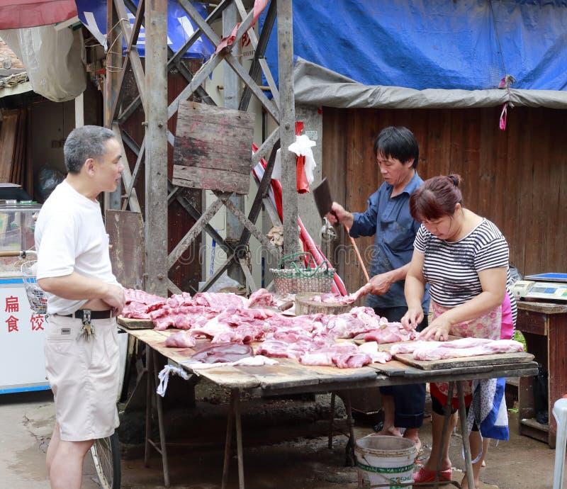 De venters verkopen varkensvlees stock fotografie