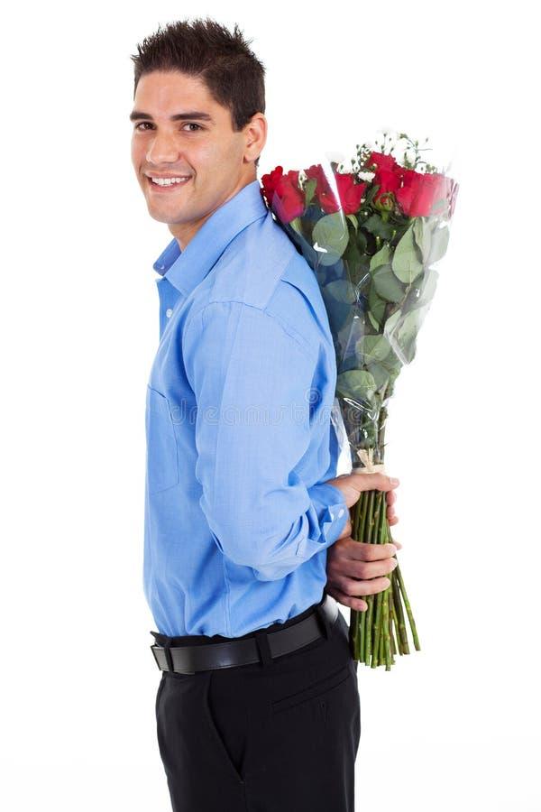De verbergende rozen van de mens royalty-vrije stock fotografie