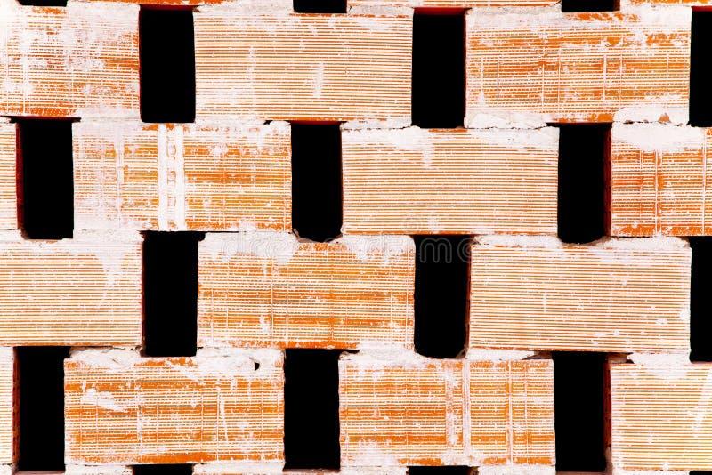 De verdelingsmuur van de baksteen met gaten voor luchtstroom stock foto's