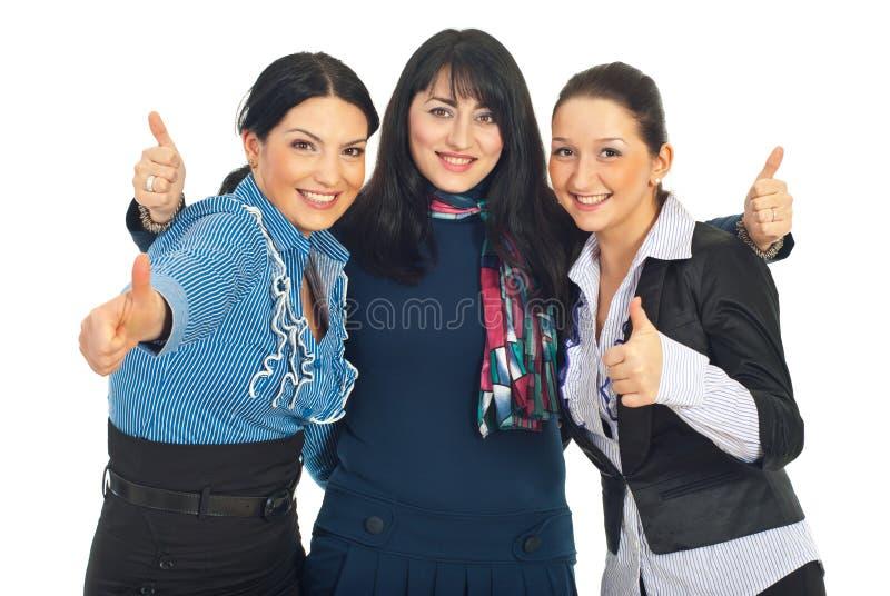 De verenigde bedrijfsvrouwen geeft duimen stock foto