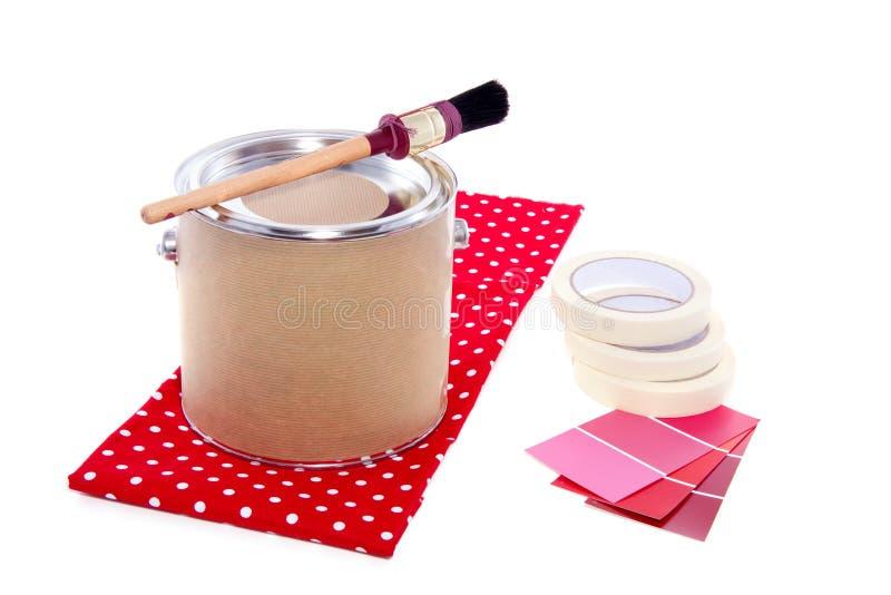 De verf kan met rode kleurensteekproeven stock foto