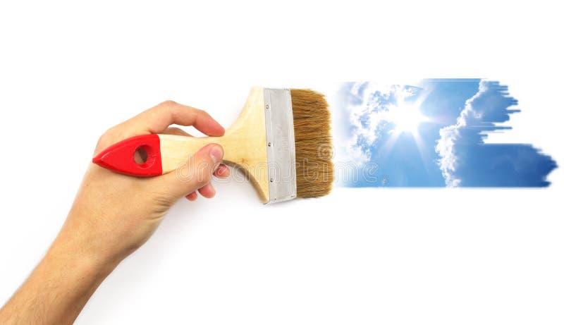 De verf van de hand de hemel stock fotografie