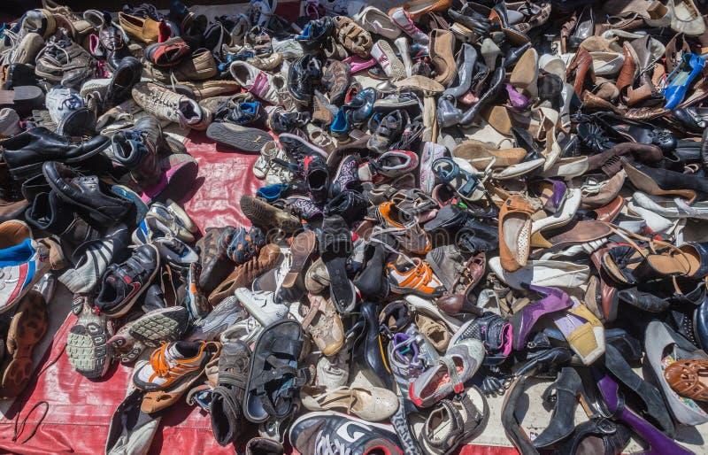 De Verkoper van de Tweede Hand van schoenen stock afbeelding
