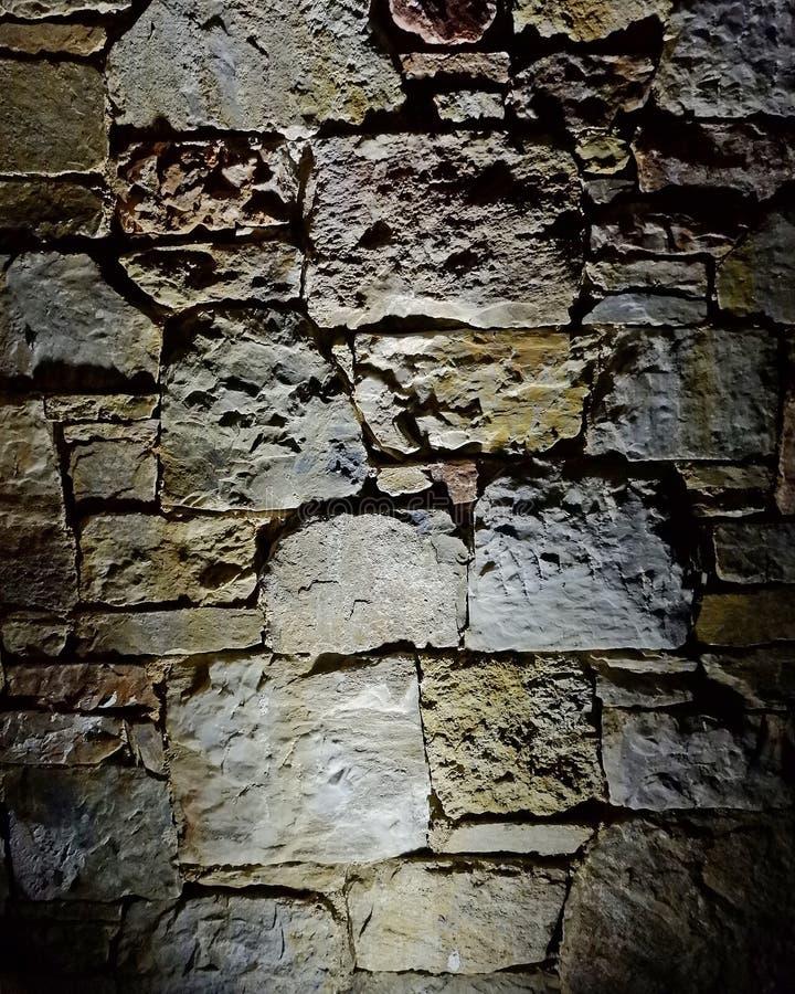 De verlichte achtergrond van de steenmuur, ruimte voor het typen stock afbeelding