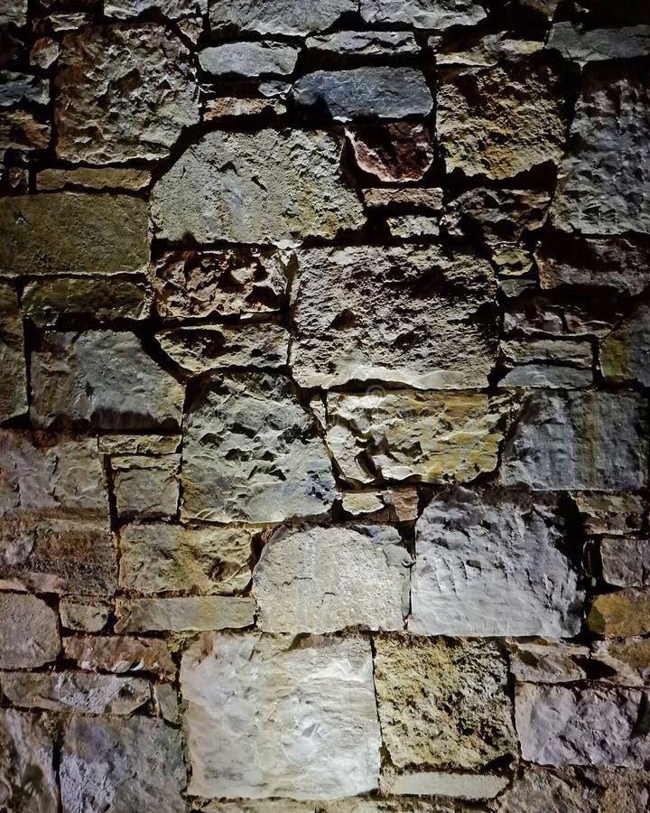De verlichte achtergrond van de steenmuur, ruimte voor het typen royalty-vrije stock fotografie