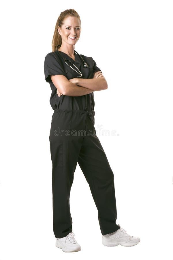 De verpleegster die net in zwarte onder ogen ziet schrobt royalty-vrije stock afbeeldingen