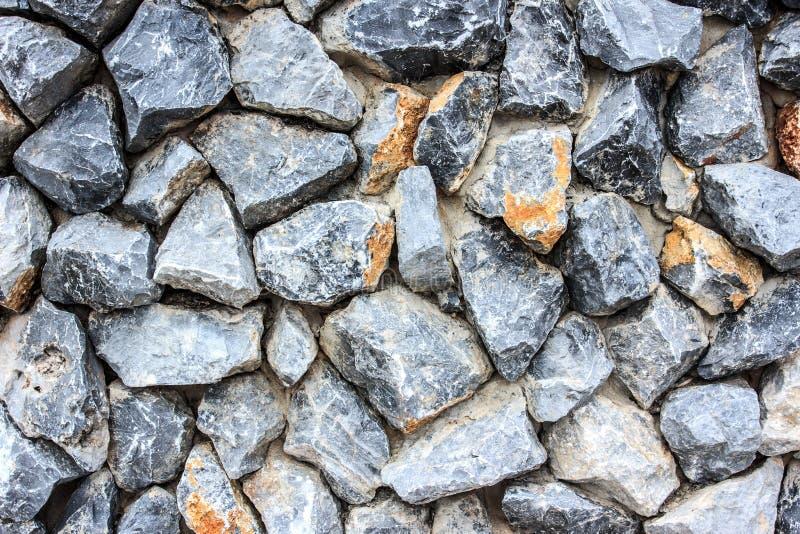 De verpletterde achtergrond van de natuursteenmuur royalty-vrije stock afbeelding
