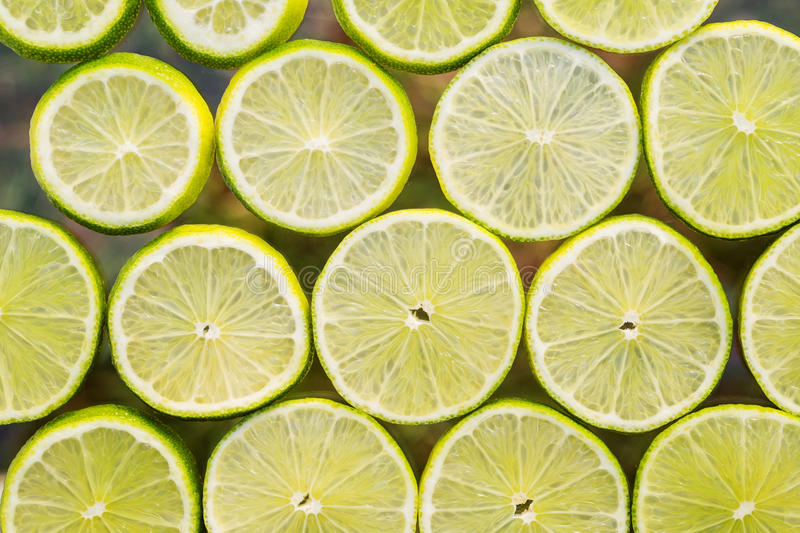De vers fruitplakken vatten naadloze patroonachtergrond, groen l samen stock foto's