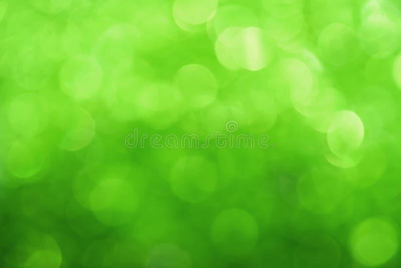 De verse groene abstracte achtergrond van bokehlichten stock foto