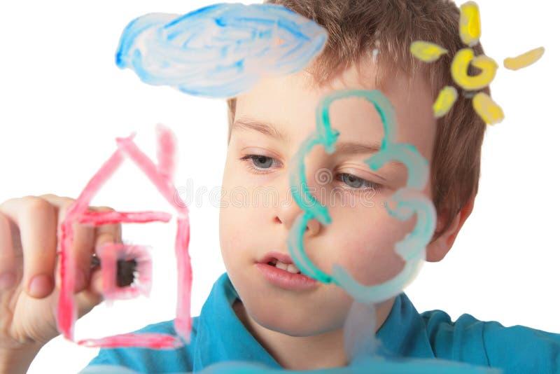 De verven van het kind op glas stock foto's