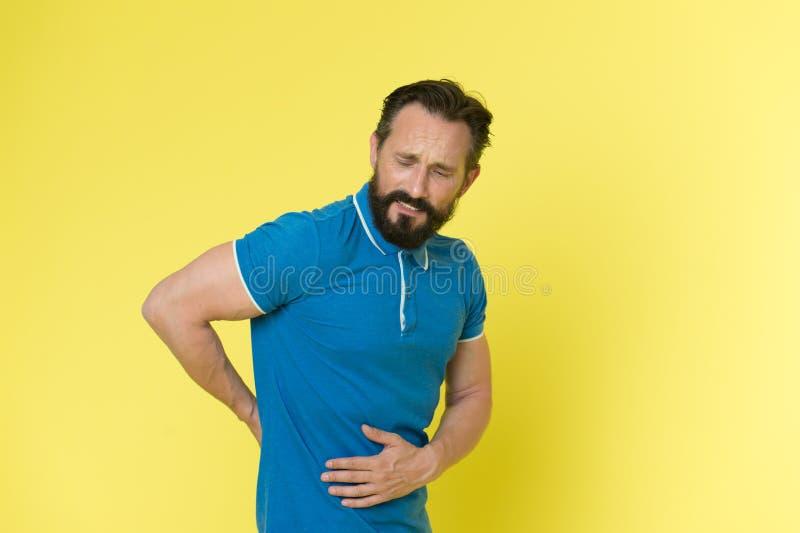 De verwonding van sporten Pijnlijke gezicht van de mensen het rijpe sportman gekregen verwond De problemen met gezondheid verschi royalty-vrije stock foto's
