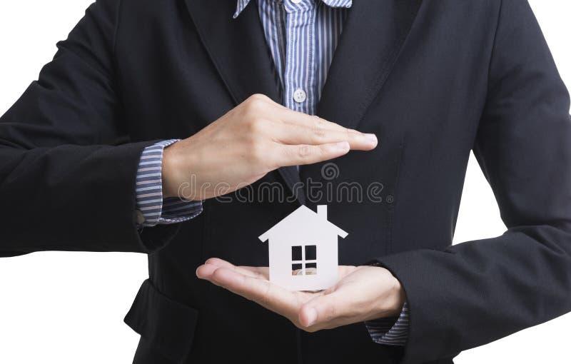De verzekering van het de holdingshuis van de bedrijfsverkopershand stock foto