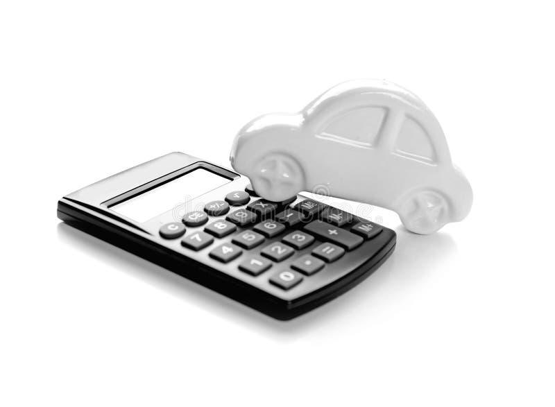 De verzekeringsconcept van de gezondheid Stuk speelgoed auto en calculator royalty-vrije stock afbeeldingen