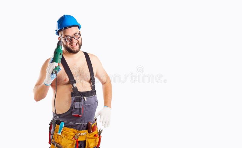 De vette grappige mensenbouwer met een boor stock afbeelding