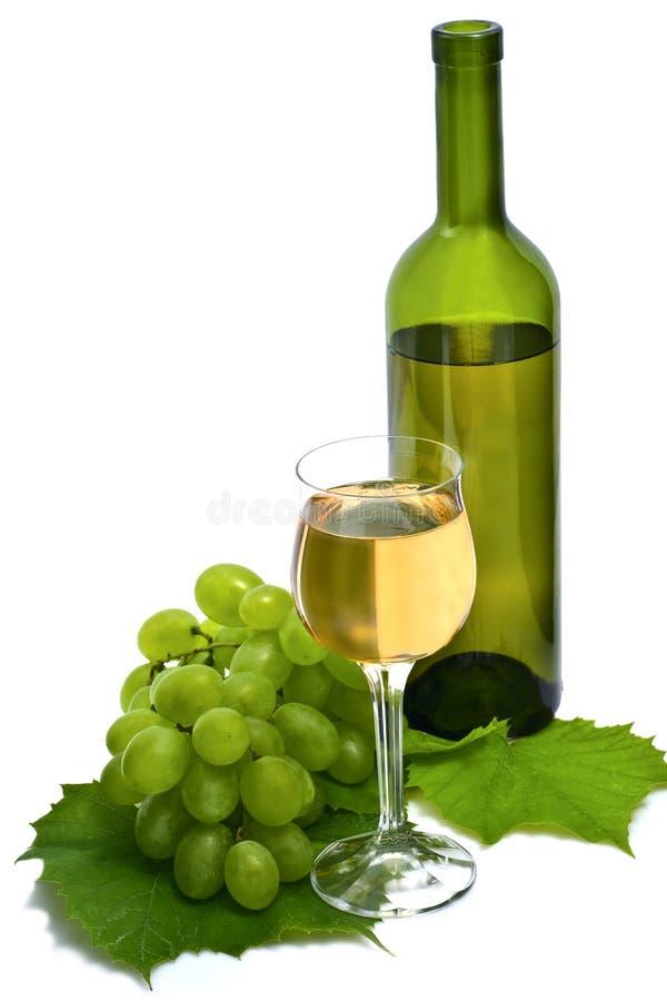 De vidro e engarrafado do vinho branco fotos de stock