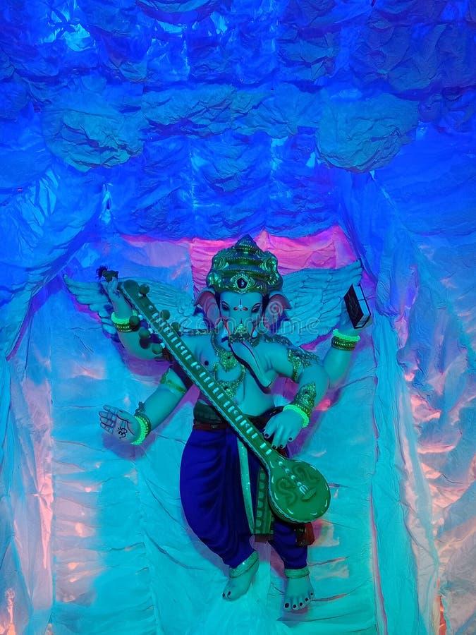 De viering van het Ganpatifestival in India stock foto's