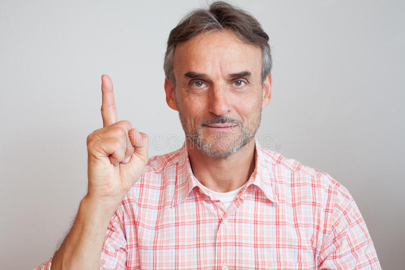 De vinger van de de hogere uitvoerende machtbedrijfsleider omhoog royalty-vrije stock fotografie