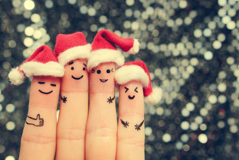 De vingerkunst van vrienden viert Kerstmis stock fotografie