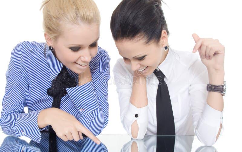 De vingerspiegel van de twee vrouwenwijzer stock afbeelding